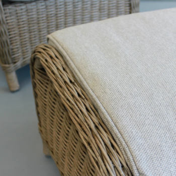 Close up of outdoor furniture wicker footstool and cushion from Mountain Weave